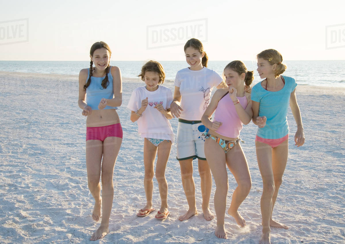 Group Of S Dancing On Beach