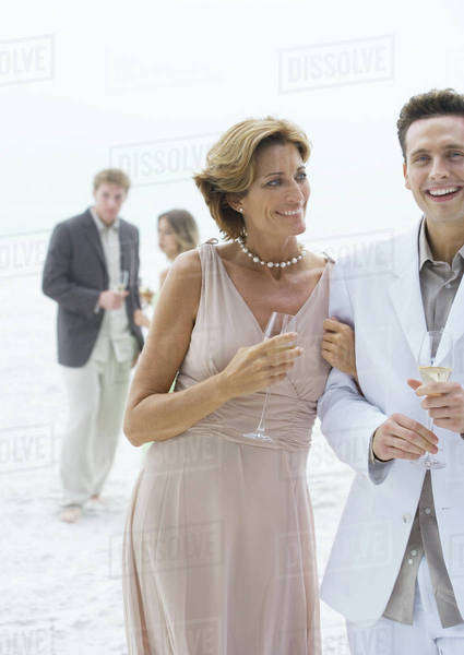 People dressed in formal clothing on beach Royalty-free stock photo
