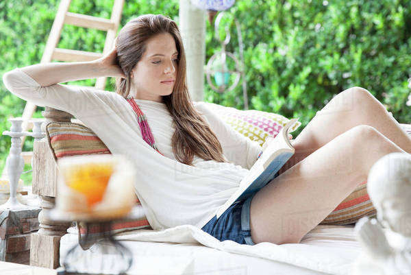 Young woman reading book outdoors Royalty-free stock photo