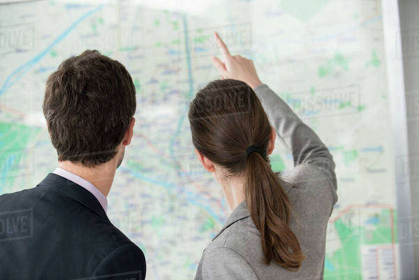 Man and woman looking at Paris metro map together Royalty-free stock photo