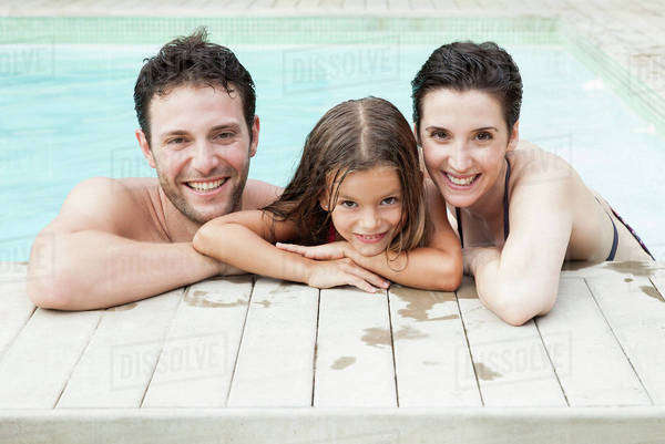Family relaxing together in pool, portrait Royalty-free stock photo