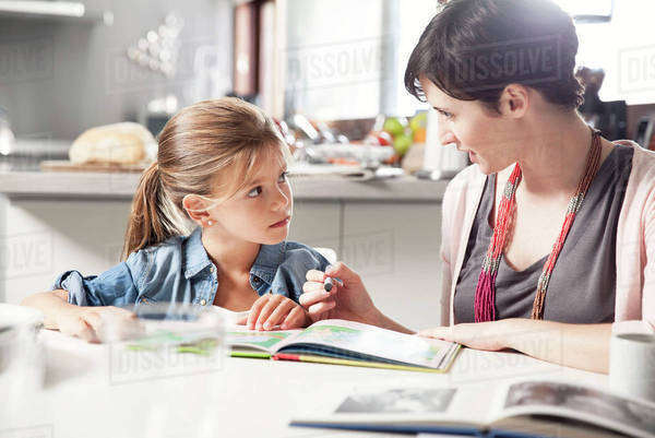 Mother and young daughter reading together Royalty-free stock photo