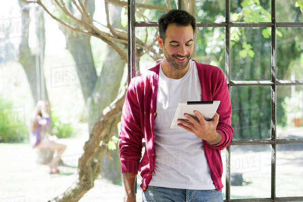 Man relaxing with digital tablet Royalty-free stock photo