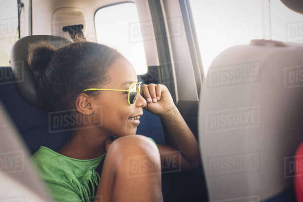 Girl looking out car window Royalty-free stock photo