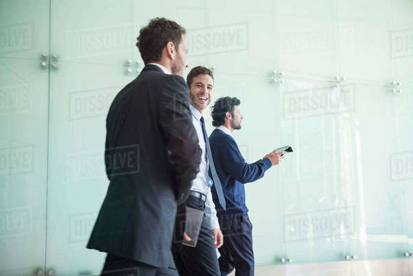 Business associates chatting while walking together Royalty-free stock photo