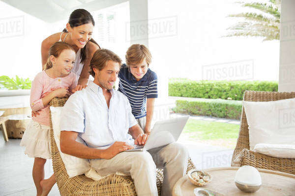 Family using laptop in living room Royalty-free stock photo