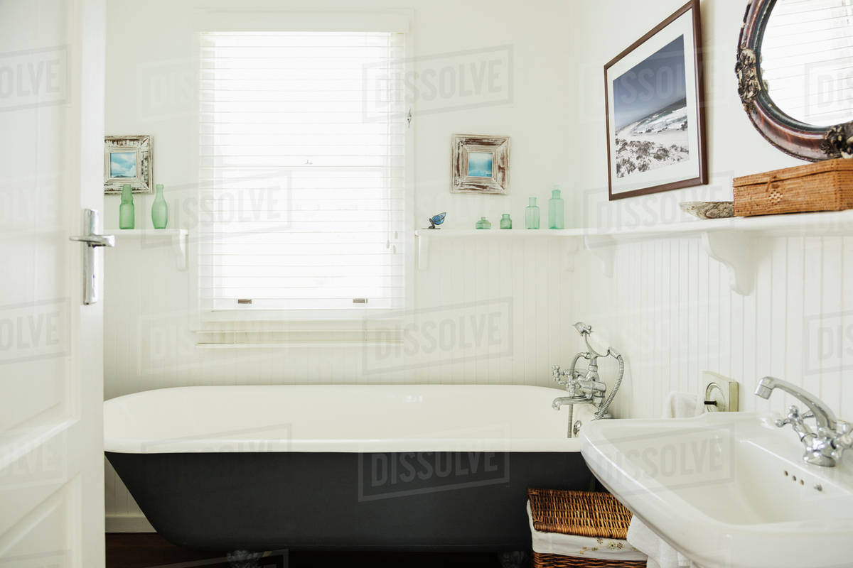 Claw foot bathtub in ornate bathroom - Stock Photo - Dissolve