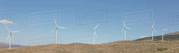 Wind turbines spinning in rural landscape Royalty-free stock photo