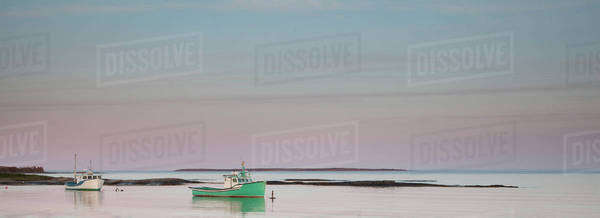 Fishing boats in calm bay Royalty-free stock photo