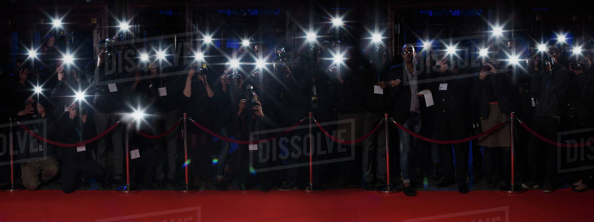 Paparazzi using flash photography along red carpet Royalty-free stock photo