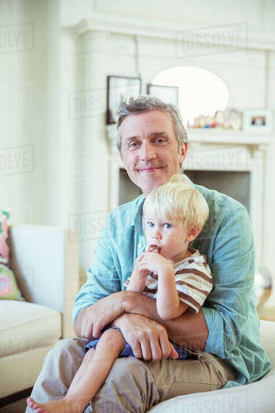 Father holding son in living room Royalty-free stock photo