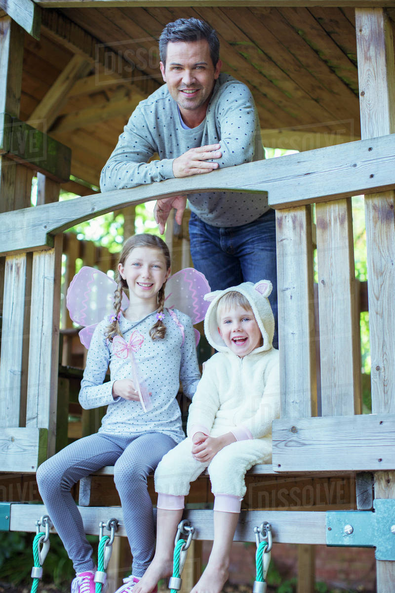 Father and children playing on playset Royalty-free stock photo