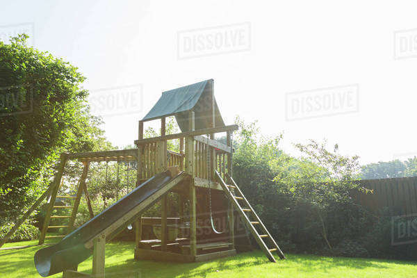 Play structure in backyard Royalty-free stock photo