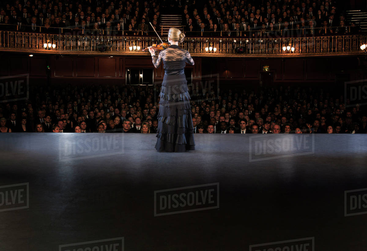 Violinist performing on stage in theater Royalty-free stock photo
