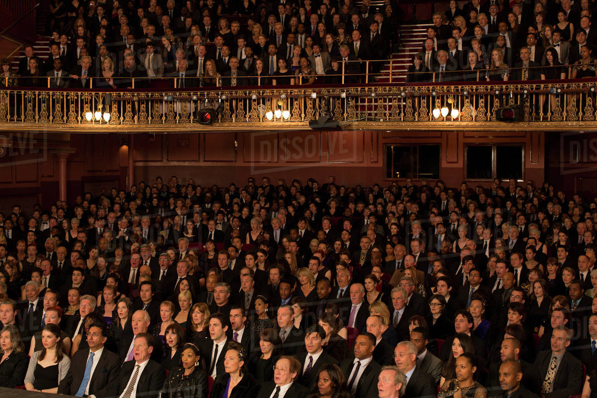 Audience watching performance in theater Royalty-free stock photo