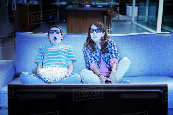 Children watching 3D television in living room Royalty-free stock photo