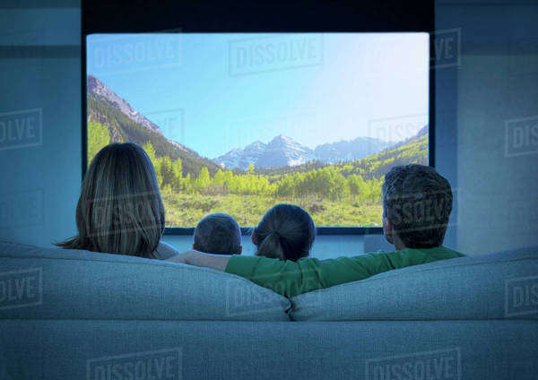 Family watching television in living room Royalty-free stock photo