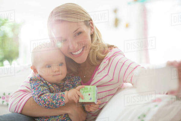 Mother taking self-portrait with baby girl Royalty-free stock photo