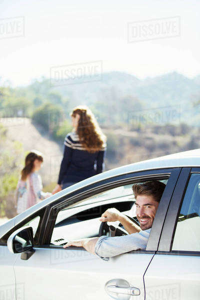 Portrait of happy man inside of car Royalty-free stock photo
