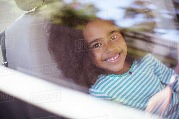 Portrait of happy girl in back seat of car Royalty-free stock photo