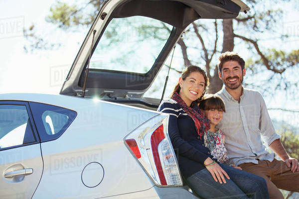 Portrait of happy family at back of car Royalty-free stock photo