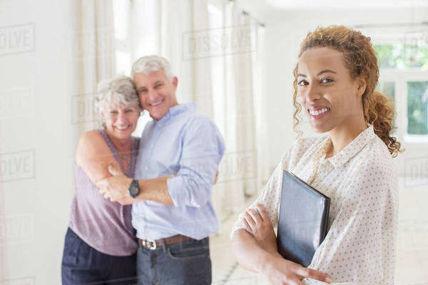 Older couple hugging with woman smiling  Royalty-free stock photo