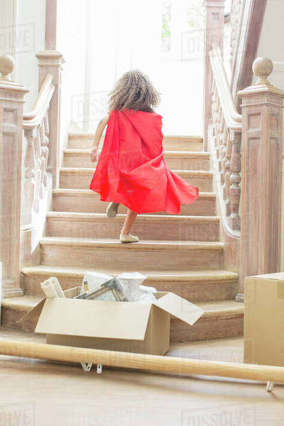 Young girl running up stairs playing  Royalty-free stock photo