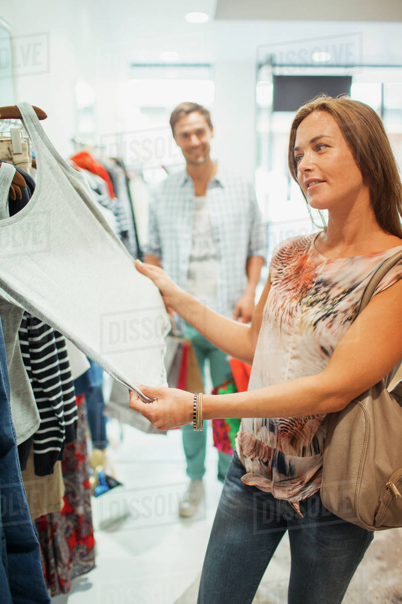 89c7280800 Couple shopping together in clothing store - Stock Photo - Dissolve