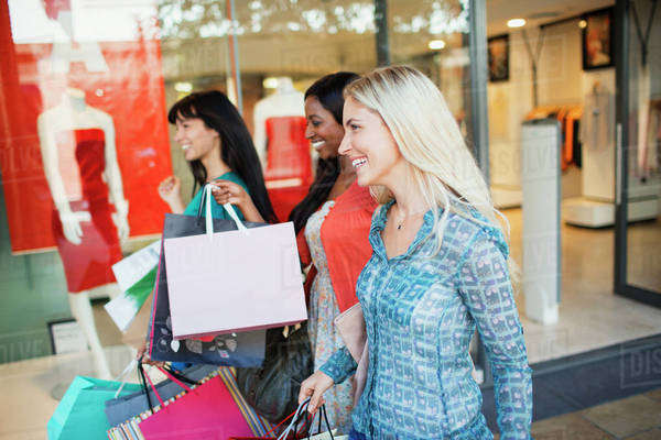 Women carrying shopping bags in shopping mall Royalty-free stock photo