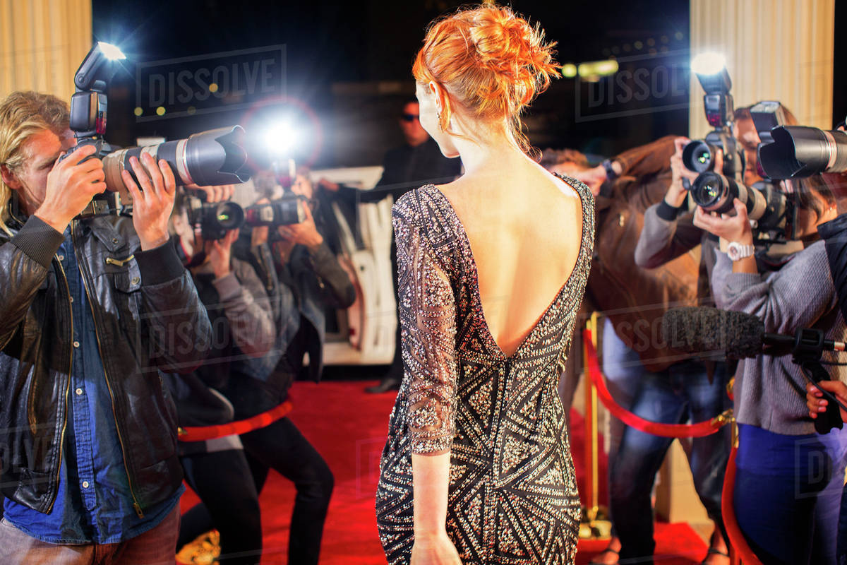 Celebrity leaving and being photographed by paparazzi photographers at red carpet event stock - Red carpet photographers ...