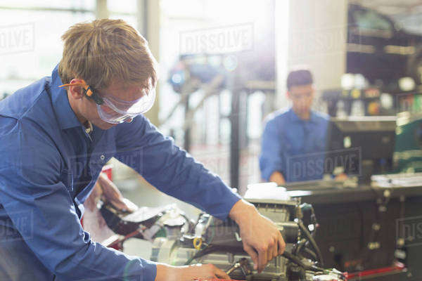 Mechanic working on engine in auto repair shop Royalty-free stock photo
