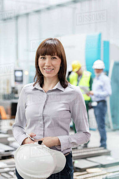 Portrait smiling engineer with hard-hat in factory Royalty-free stock photo