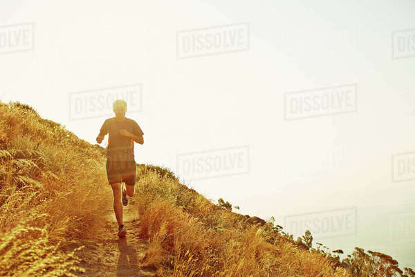 Man running on sunset trail Royalty-free stock photo