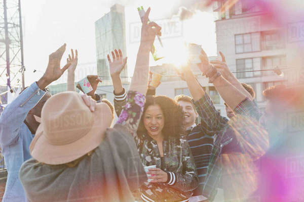 Young adults dancing at rooftop party Royalty-free stock photo