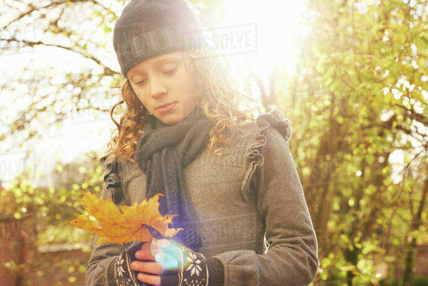 Girl carrying autumn leaf outdoors Royalty-free stock photo