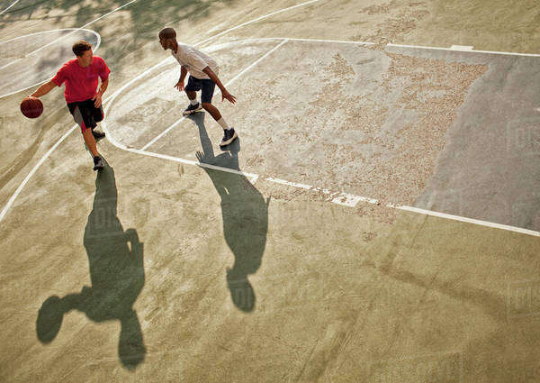 Men playing basketball on court Royalty-free stock photo