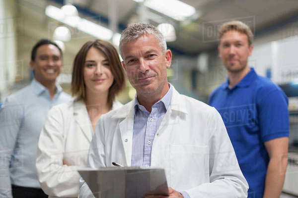 Portrait smiling engineer team in steel factory Royalty-free stock photo