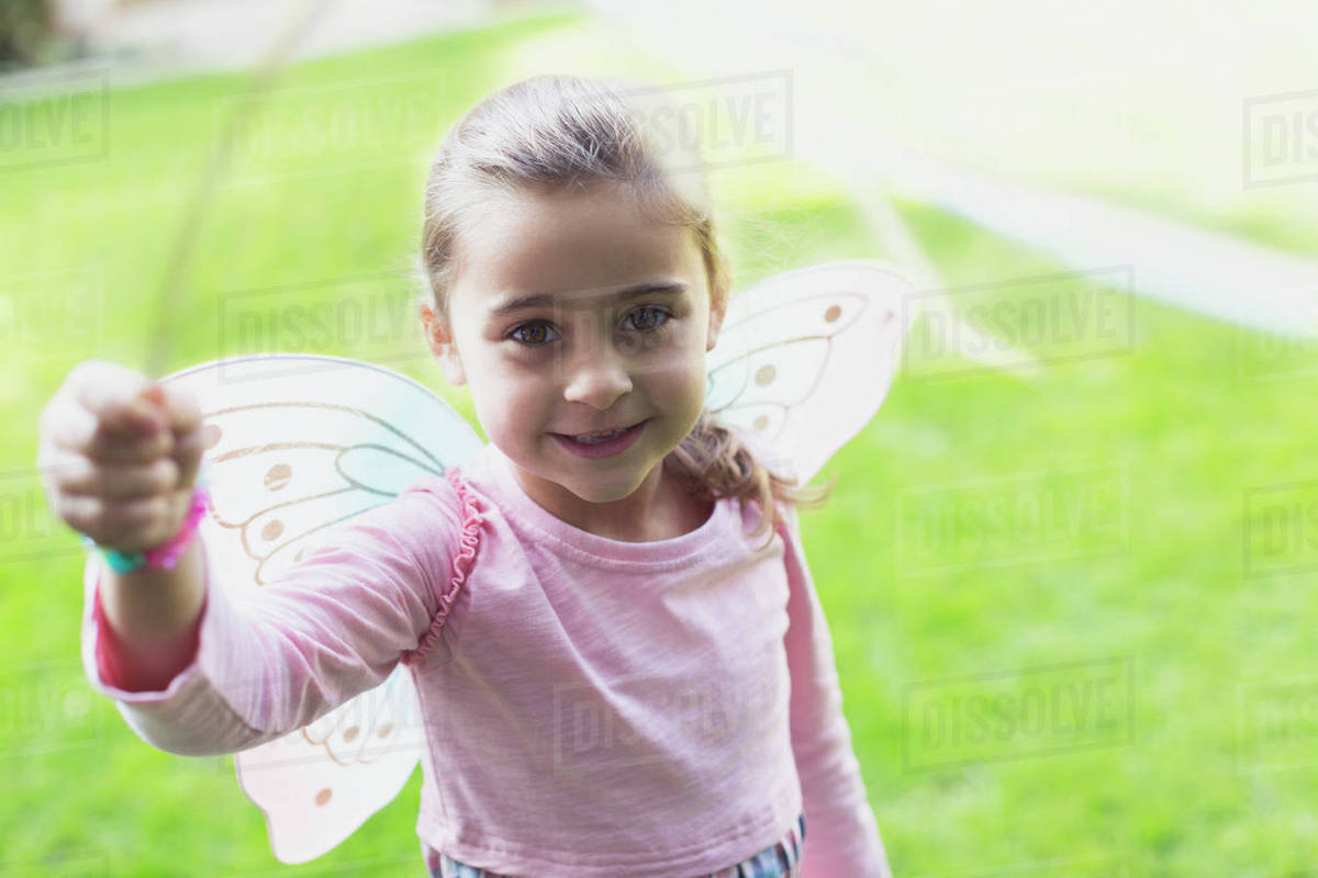 Portrait smiling girl in fairy wings Royalty-free stock photo