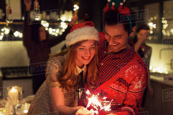 Playful couple with Christmas sparklers Royalty-free stock photo