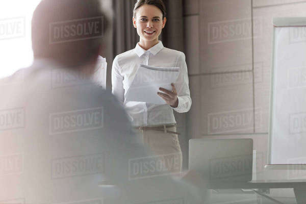 Businesswoman with paperwork leading meeting in conference room Royalty-free stock photo
