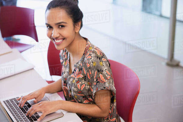 Portrait smiling college student using laptop Royalty-free stock photo