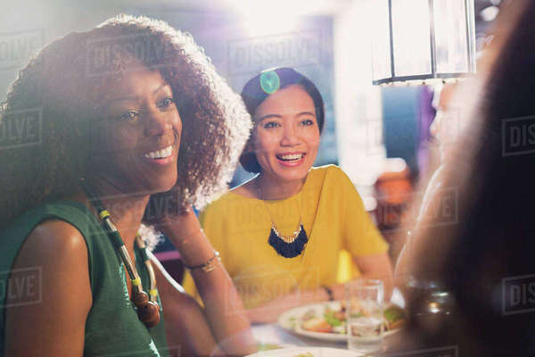 Women friends talking and dining at restaurant table Royalty-free stock photo