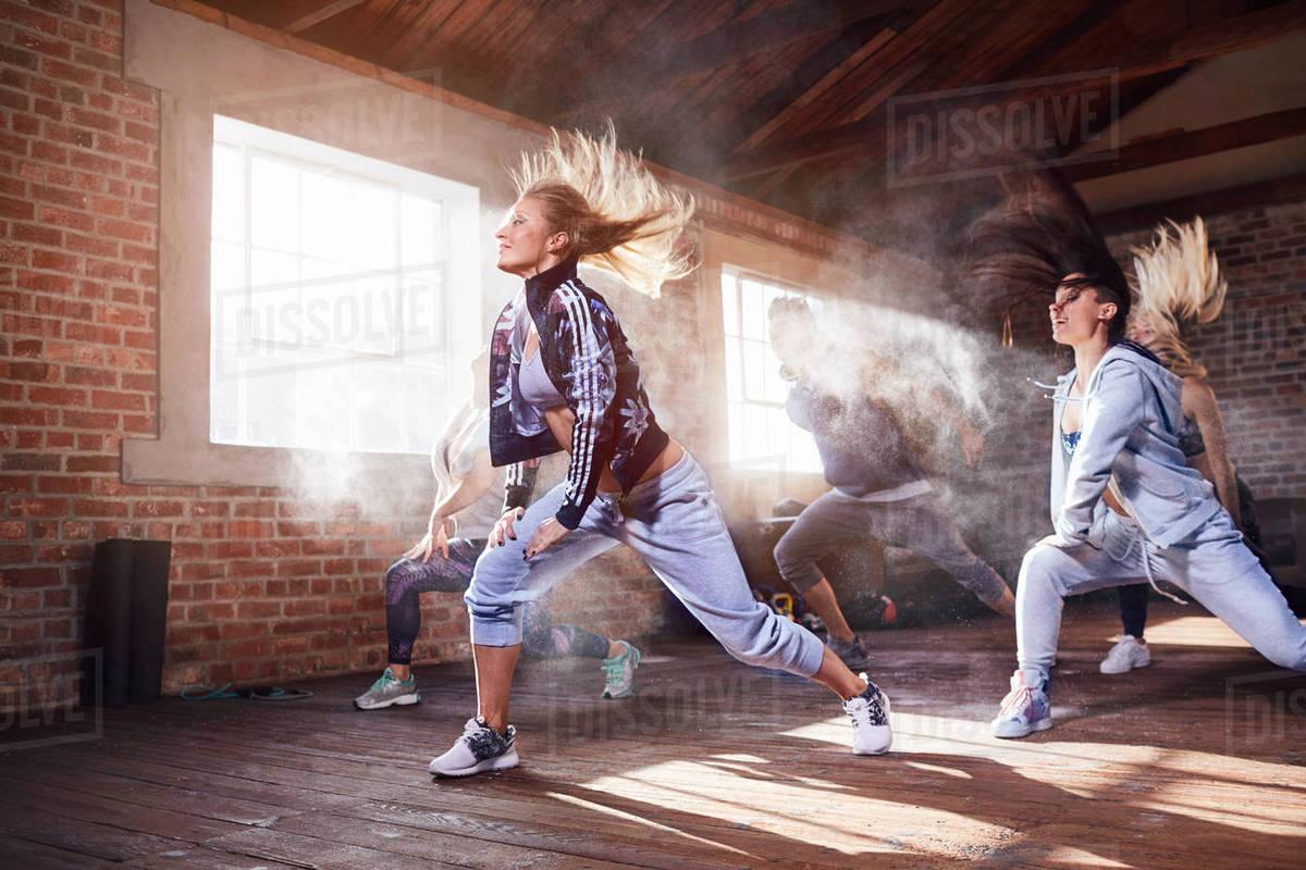 Young women hip hop dancers dancing in studio stock photo
