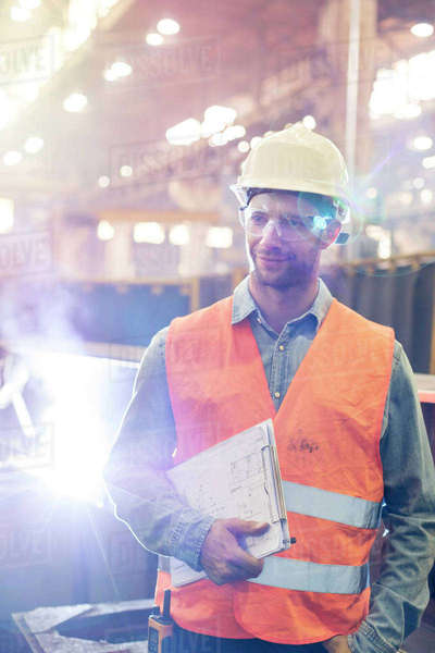 Steel worker with clipboard in factory Royalty-free stock photo