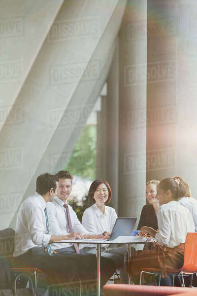 Smiling business people talking in conference room meeting Royalty-free stock photo