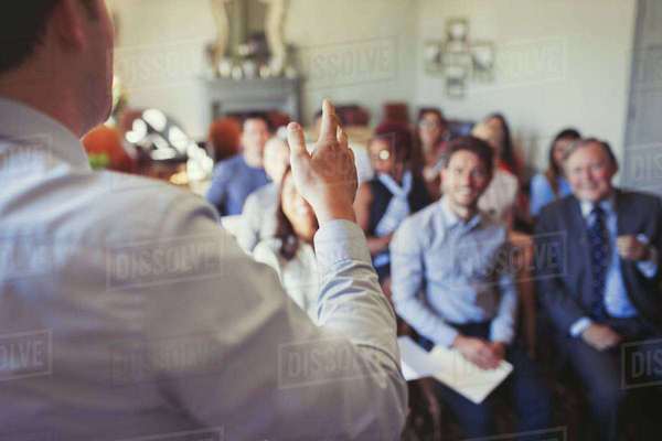 Business people in audience watching businessman leading business conference Royalty-free stock photo