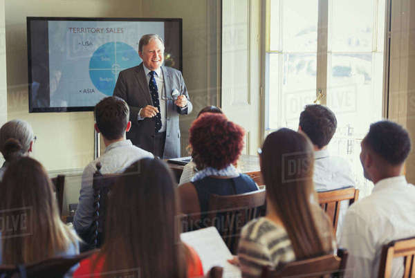Businessman leading conference presentation at television screen Royalty-free stock photo