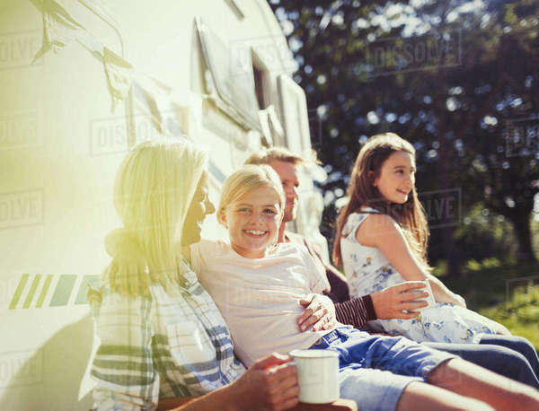 Portrait smiling girl hugging mother outside sunny motor home Royalty-free stock photo