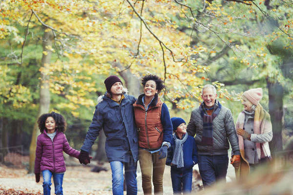 Multi-generation family walking in autumn woods Royalty-free stock photo