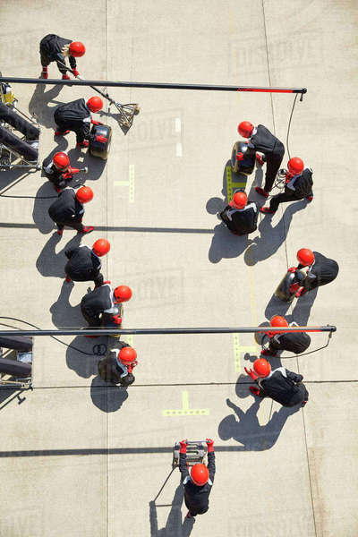Overhead formula one pit crew ready at pit stop Royalty-free stock photo